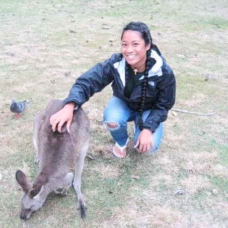 woman petting a kangaroo